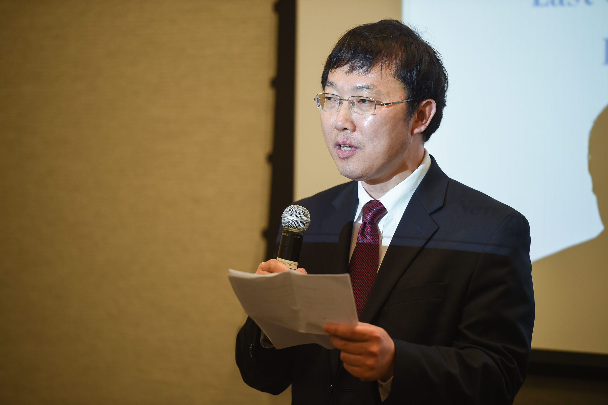 ECNU vice president Wang Rongming delivers the opening speech.